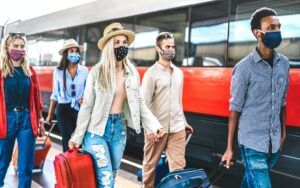 People traveling with face mask on new normal covid restrictions