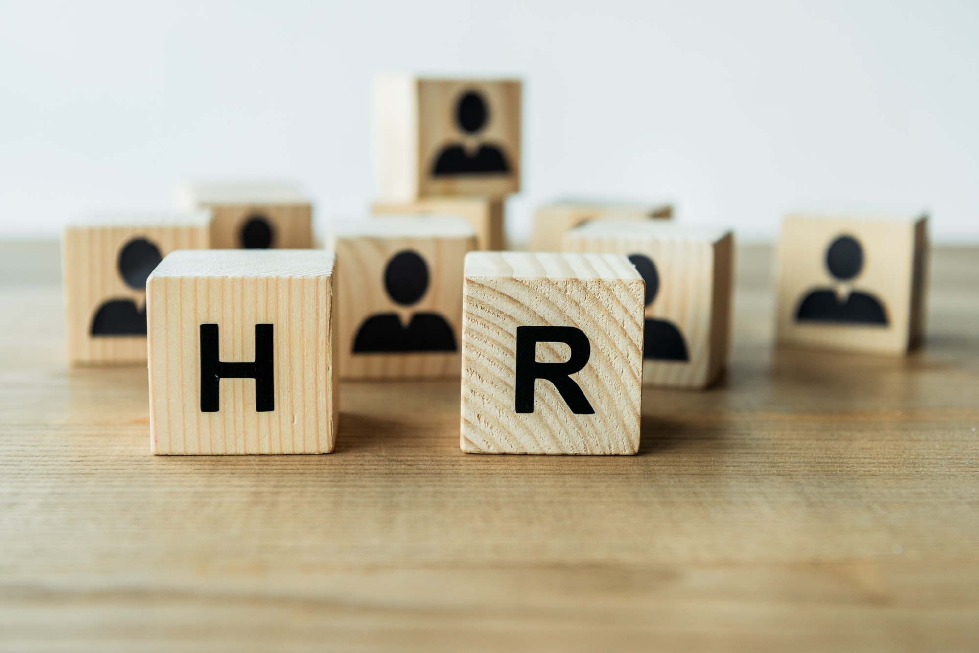 selective focus of hr lettering on wooden cubes on table